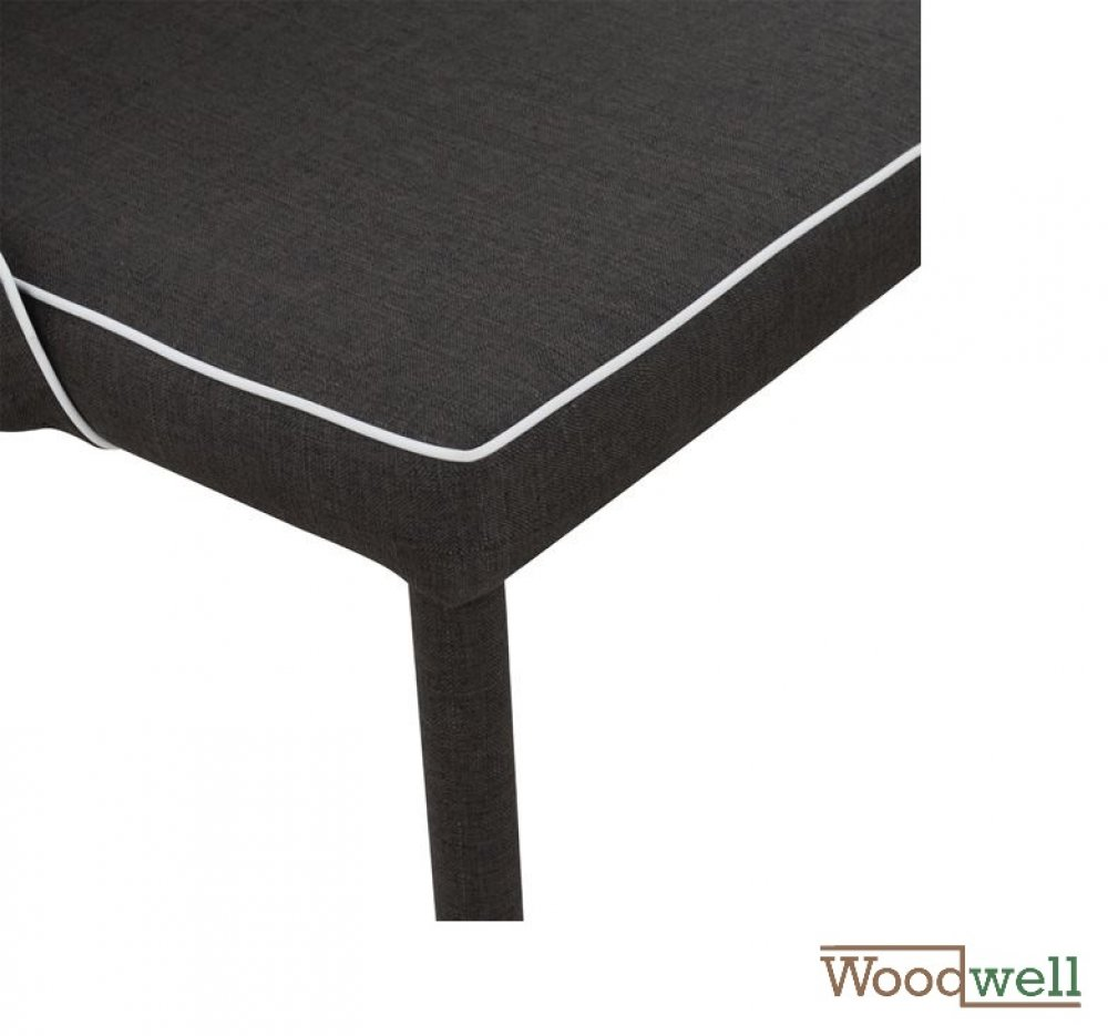 Modern shell chair covered with black fabric and white edge